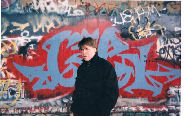 "Gallery Director Chris Murray at D.C.'s graffiti ""wall of fame"""