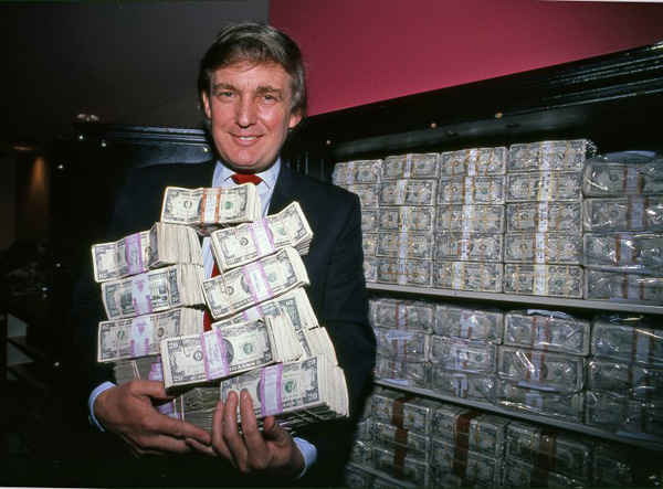 Donald Trump holding one million dollars. © Harry Benson.