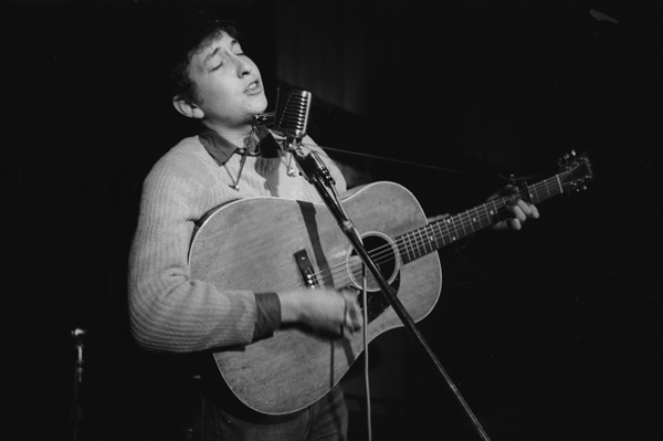 Bob Dylan performing at Gerde's Folk City in Greenwich Village, 1961. © Ted Russell.