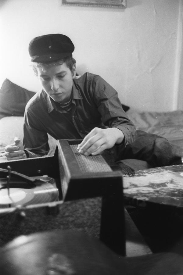 Dylan playing a record