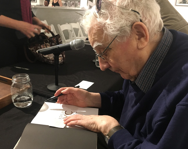 Ted Russell signing books at the panel discussion.